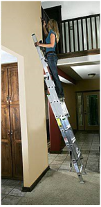 woman on extension ladder