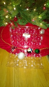 Re use store packages for fruits to store Christmas ornament